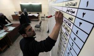 An election official tallies votes in Amman, Jordan